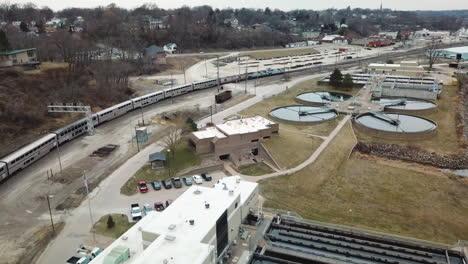 Aerial-of-the-Southwest-Chief-Amtrak-train-traveling-through-a-railroad-yard-near-Burlington-Iowa