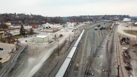 Aerial-of-the-Southwest-Chief-Amtrak-train-traveling-through-a-railroad-yard-near-Burlington-Iowa-1