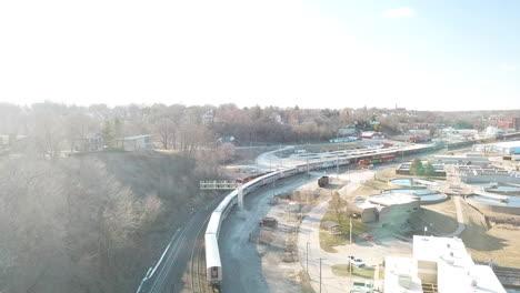 Aerial-of-the-Southwest-Chief-Amtrak-train-traveling-through-a-railroad-yard-near-Burlington-Iowa-2