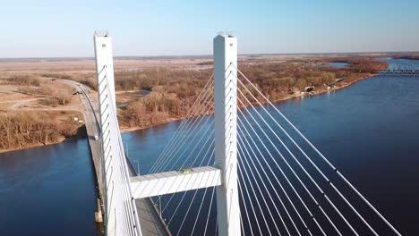 Aerial-of-a-suspension-bridge-crossing-the-Mississippi-River-near-Burlington-Iowa-follows-a-truck