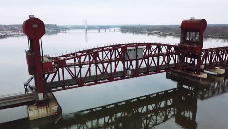 Aerial-shot-of-a-railroad-drawbridge-lifting-or-raising-over-the-Mississippi-River-near-Burlington-Iowa