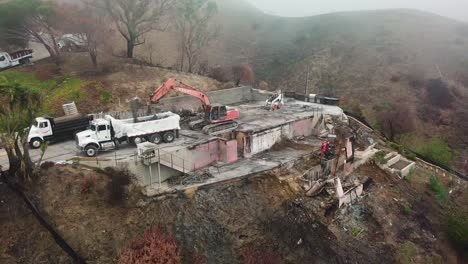 Aerial-of-a-house-being-bulldozed-on-a-hillside-in-Ventura-following-the-destruction-of-Thomas-Fire