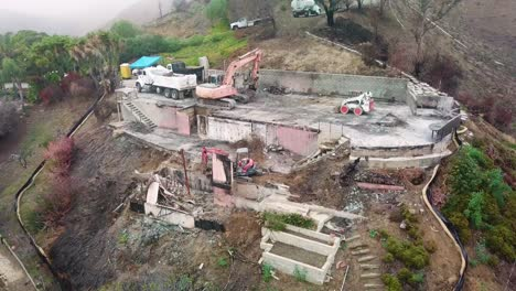 Aerial-of-a-house-being-bulldozed-on-a-hillside-in-Ventura-following-the-destruction-of-Thomas-Fire-3