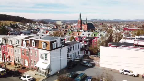 Rising-vista-aérea-of-typical-Pennsylvania-town-with-rowhouses-and-large-church-or-cathedral-distant-Reading-PA
