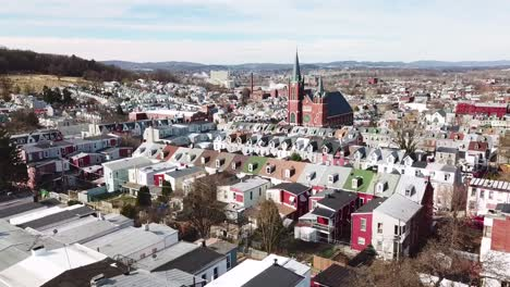 Aerial-of-typical-Pennsylvania-town-with-rowhouses-and-large-church-or-cathedral-distant-Reading-PA