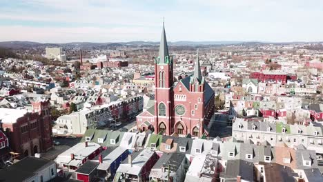Aerial-of-typical-Pennsylvania-town-with-rowhouses-and-large-church-or-cathedral-distant-Reading-PA-1