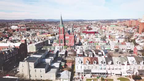 Aerial-of-typical-Pennsylvania-town-with-rowhouses-and-large-church-or-cathedral-distant-Reading-PA-2