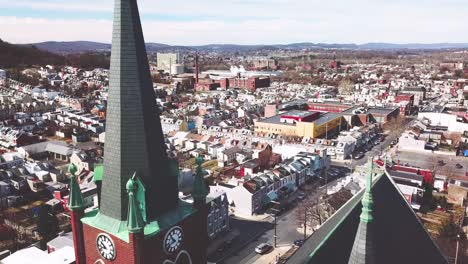 Aerial-of-typical-Pennsylvania-town-with-rowhouses-and-large-church-or-cathedral-distant-Reading-PA-4