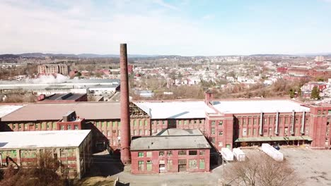 Aerial-over-an-abandoned-American-factory-with-smokestack-near-Reading-Pennsylvania