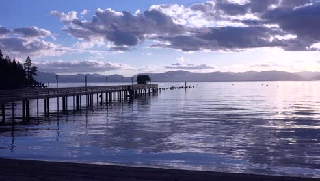 A-beautiful-sunset-behind-a-resort-and-silhouetted-pier-at-Glenbrook-Lake-Tahoe-Nevada-1