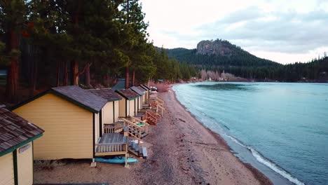 Aerial-of-summer-cabins-and-cabanas-lining-the-shores-of-a-resort-at-Lake-Tahoe-Nevada