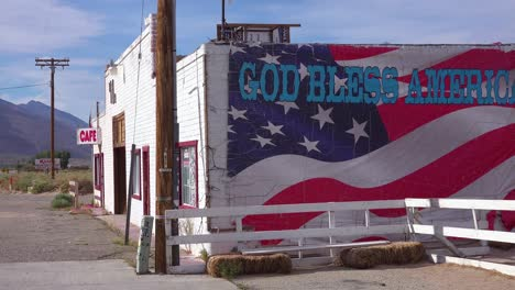 A-roadside-cafe-along-a-remote-highway-and-God-Bless-America-sign