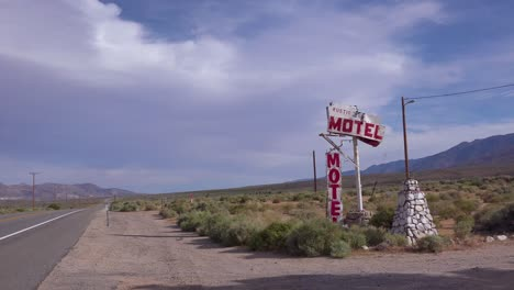 An-abandoned-or-rundown-old-rustic-motel-along-a-rural-road-in-America-1