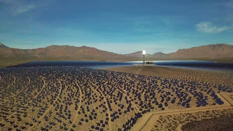 Drone-aerial-over-a-vast-solar-power-generating-facility-at-Primm-Nevada