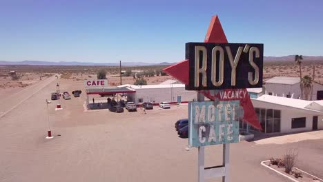 Drone-aerial-over-a-lonely-desert-gas-station-and-hotel-motel-cafe-in-the-Mojave-Desert
