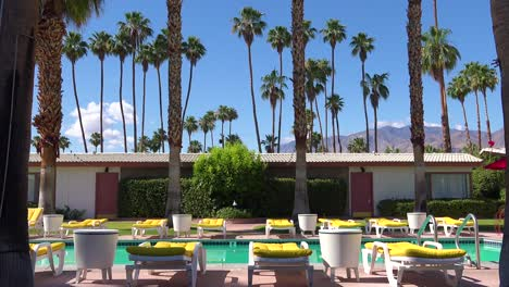 Establishing-shot-of-a-classic-retro-motel-in-Palm-Springs-or-Los-Angeles-California-will-swimming-pool-and-deck-chairs-1
