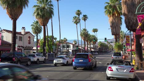 Good-establishing-shot-of-Palm-Canyon-Drive-and-traffic-in-downtown-Palm-Springs-California