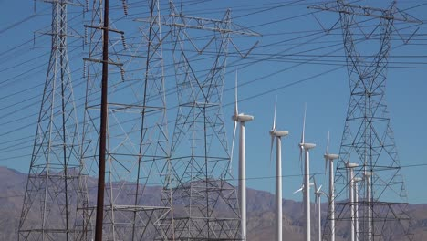 Wind-turbines-spin-in-the-desert-near-power-lines-and-poles-Mojave-desert-Palm-Springs-California
