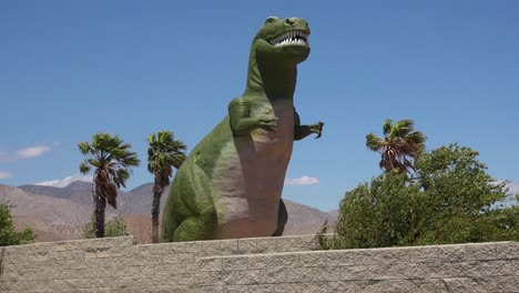 A-giant-artifical-dinosaur-looms-over-visitors-as-a-roadside-attraction-in-the-Mojave-Desert-near-Cabazon-California