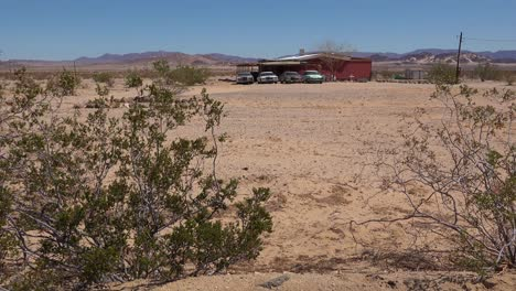 Old-classic-Cadillac-cars-and-other-vintage-automobiles-sit-outside-a-remote-ranch-house-in-the-Mojave-Desert-1