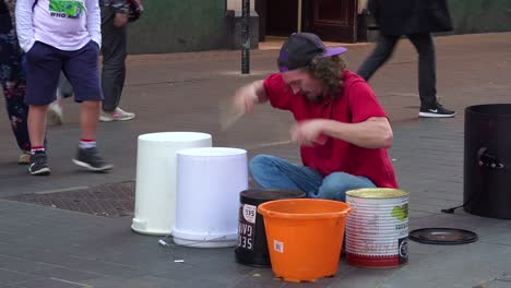 A-street-musician-plays-drums-on-a-London-street