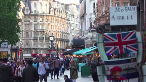 Lots-of-foot-traffic-and-pedestrians-move-through-Leicester-Square-London-England-1