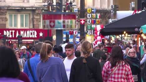 Large-crowds-of-people-move-through-Leicester-Square-London-England-at-rush-hour