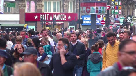 Large-crowds-of-people-move-through-Leicester-Square-London-England-at-rush-hour-1