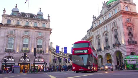 Early-evening-doubledecker-bus-and-London-taxi-traffic-moves-through-Piccadilly-Circus-2