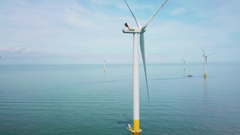 Remarkable-rising-drone-aerial-over-windmills-and-turbines-in-the-ocean-off-the-coast-of-England
