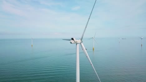 Remarkable-drone-aerial-over-windmills-and-turbines-in-the-ocean-off-the-coast-of-England
