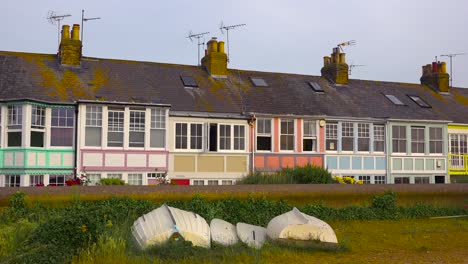 Pretty-and-colorful-rowhouses-or-cottages-line-a-beach-at-a-seaside-resort-in-England