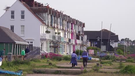 Pretty-and-colorful-rowhouses-or-cottages-line-a-beach-at-a-seaside-resort-in-England-1