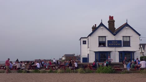 Good-establishing-shot-of-an-outdoor-picnic-area-at-a-pub-in-Whitstable-Bay-Kent-England-on-the-Thames-Estuary