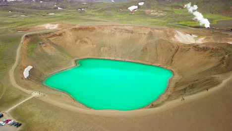 Beautiful-drone-shot-of-the-Krafla-geothermal-area-in-Iceland-with-green-lakes-and-steaming-hot-pots-1