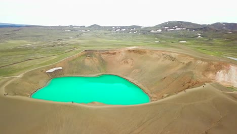 Beautiful-drone-shot-of-the-Krafla-geothermal-area-in-Iceland-with-green-lakes-and-steaming-hot-pots-2