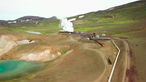 Beautiful-drone-shot-of-the-Krafla-geothermal-area-in-Iceland-with-pipes-and-sheep-warming-themselves