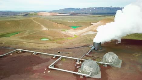 Beautiful-drone-shot-of-the-Krafla-geothermal-area-in-Iceland-with-pipes-steaming-vents-and-sheep-warming-themselves