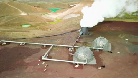 Beautiful-drone-shot-of-the-Krafla-geothermal-area-in-Iceland-with-pipes-steaming-vents-and-sheep-warming-themselves-1