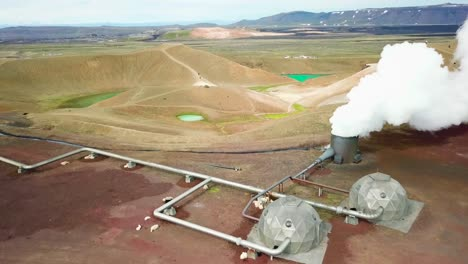 Beautiful-drone-shot-of-the-Krafla-geothermal-area-in-Iceland-with-pipes-steaming-vents-and-sheep-warming-themselves-2