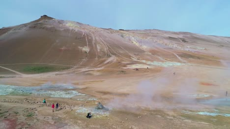 Dramatic-rising-aerial-over-Hverir-Myvatn-geothermal-area-in-iceland-reveals-the-lakes-distant-1