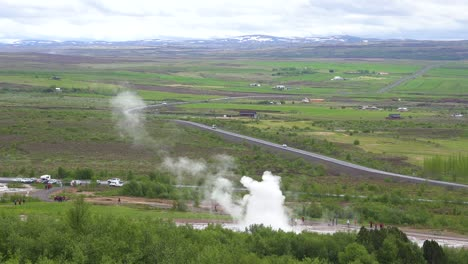 Iceland-s-famous-Strokkur-geysir-geyser-erupts-with-the-Icelandic-countryside-in-background
