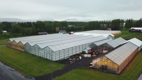 Drone-aerial-establishing-shot-of-an-Iceland-greenhouse-using-geothermal-hot-water-to-grow-fruits-and-vegetables