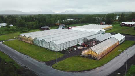 Drone-aerial-establishing-shot-of-an-Iceland-greenhouse-using-geothermal-hot-water-to-grow-fruits-and-vegetables-1
