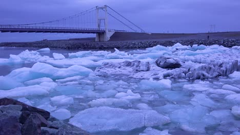 Icebergs-flow-down-a-glacial-river-suggest-global-warming-in-the-Arctic-at-Jokulsarlon-glacier-lagoon-Iceland-night
