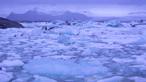 Icebergs-sit-in-a-glacial-bay-suggest-global-warming-in-the-Arctic-at-Jokulsarlon-glacier-lagoon-Iceland-night-1