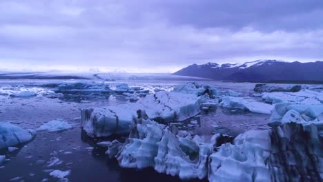 Drone-aerial-over-icebergs-in-a-glacial-bay-suggest-global-warming-in-the-Arctic-at-Jokulsarlon-glacier-lagoon-Iceland-night