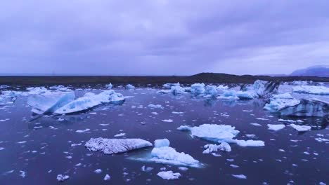 Drone-aerial-over-icebergs-in-a-glacial-bay-suggest-global-warming-in-the-Arctic-at-Jokulsarlon-glacier-lagoon-Iceland-night-2