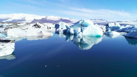 Beautiful-aerial-over-icebergs-in-the-Arctic-Jokulsarlon-glacier-lagoon-in-Iceland