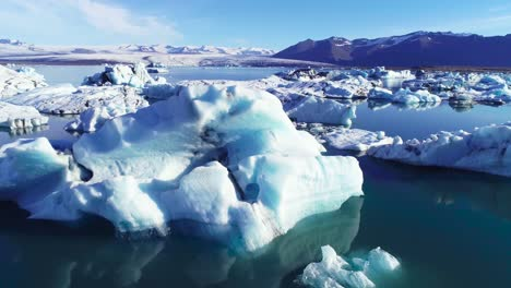 Beautiful-aerial-over-icebergs-in-the-Arctic-Jokulsarlon-glacier-lagoon-in-Iceland-8